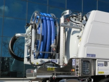 Suction boom and suction hose reel